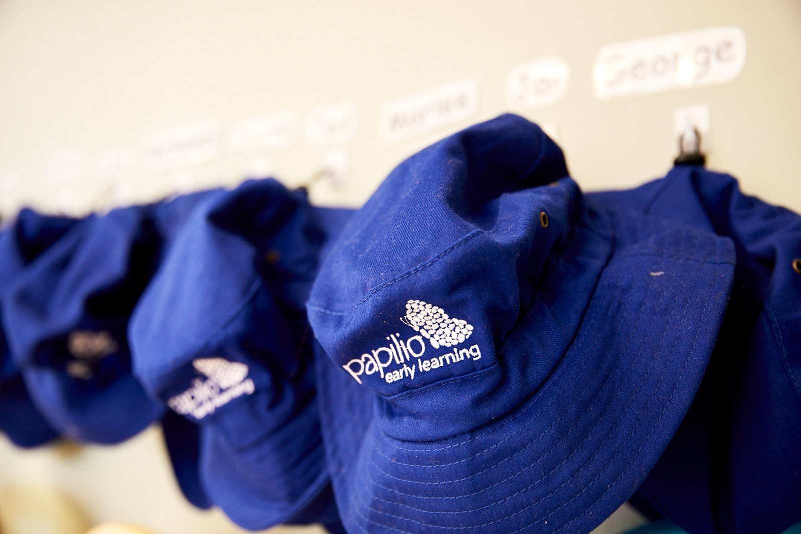 Papilio Early Learning branded hats in childcare centre