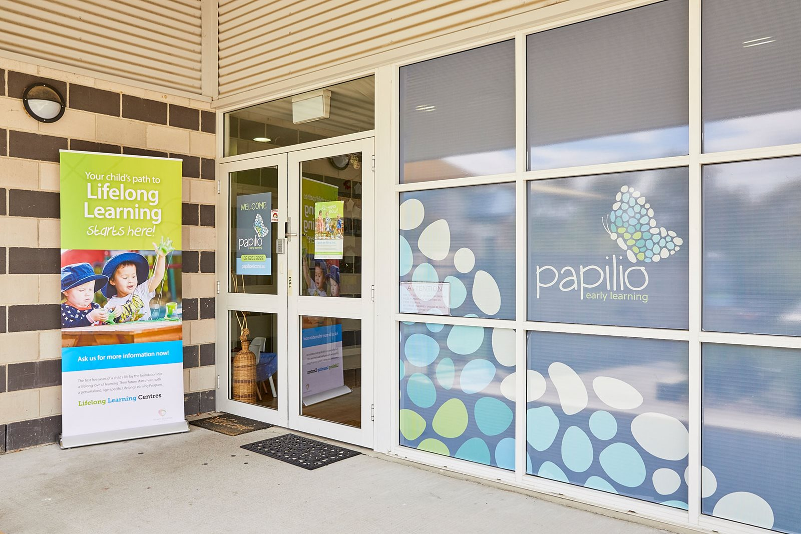Papilio Early Learning Bruce child care centre entry with signs on windows